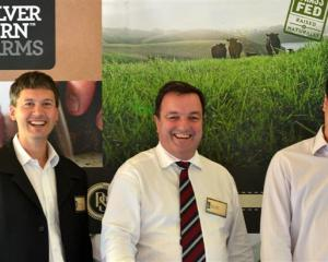 Silver Fern Farms chief executive Keith Cooper (centre) catches up with Marcus Glucina (left) and...