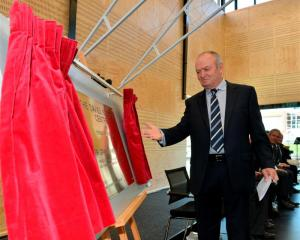 Sir Graham Henry unveils the foundation plaque;  the new $4 million centre.