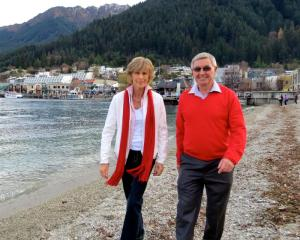 Sir John Davies and Trish, Lady Davies, stroll on the beach at Queenstown Bay on Saturday. Photo...