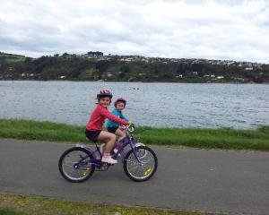 Sisters Georgia (then 6) and Matilda Hall (then 5) enjoy a ride on the West Harbour cycleway in...