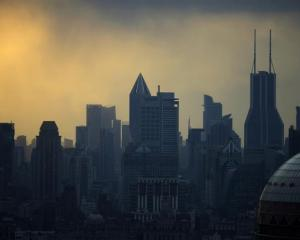 Skyscrapers in downtown Shanghai last month. Photo by Reuters.