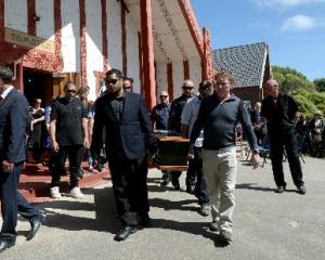 Solemn procession out of Te Whare Tamatea at a funeral at Otakou marae yesterday for Marty...