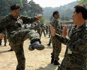 South Korean special forces reservists participate in a military drill in Jeungpyeong, southeast...