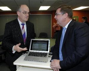 Southern DHB medical director of IT Dr Andrew Bowers (right) shows Health Minister Tony Ryall a...