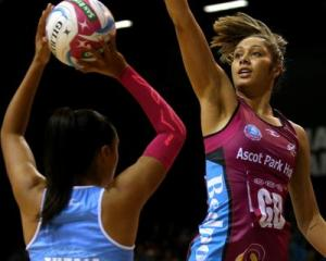 Southern Steel goal defence Phoenix Karaka (right) tries to block a shot by Northern Mystics goal...