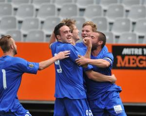 Southern United players celebrate after Andrew Ridden's goal. Photos by Gregor Richardson.