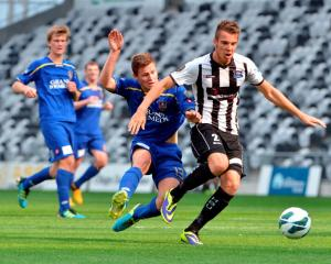 Southern United's Logan Wrightwebb  tries to stop Hawkes Bay striker Aaron Jones during an ASB...