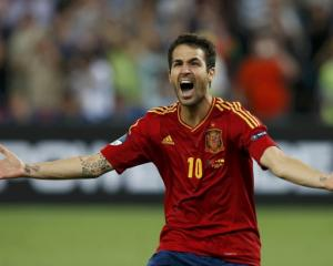 Spain's Cesc Fabregas reacts after scoring the winning penalty goal against Portugal during the...