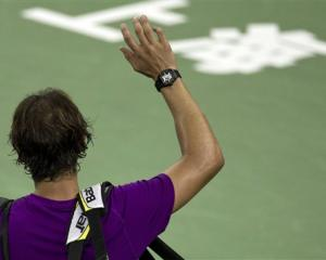 Spain's Rafael Nadal waves to spectators after losing his third-round match to Florian Mayer of...