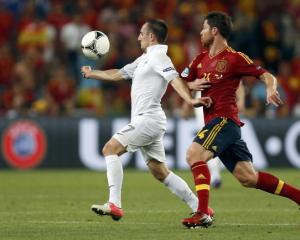 Spain's Xabi Alonso challenges France's Franck Ribery (L) during their Euro 2012 quarterfinal at...