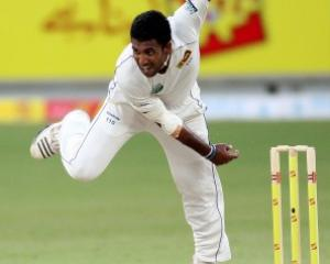 Sri Lanka's Dammika Prasad bowls during the first day of the second test against Pakistan in...