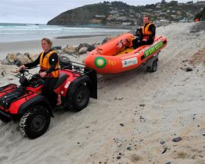 St Clair surf life-savers Carla Laughton and Rhys McAlevey try out the new ramp access from the...