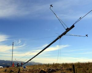 Staff from wind energy consultancy Energy 3 and Pioneer Generation install a 30m wind testing...