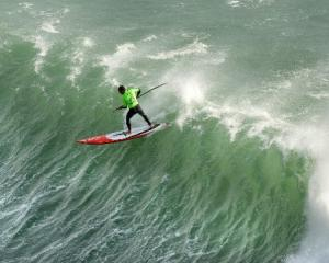 Stand-up paddleboard rider Manoa Drollet, of Tahiti, charges off the lip.