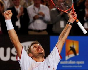 Stanislas Wawrinka celebrates his win over Novak Djokovic. REUTERS/Petar Kujundzic