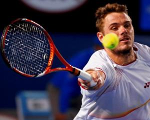 Stanislas Wawrinka hits a return to Tomas Berdych during their semifinal. REUTERS/Petar Kujundzic