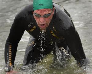 Steve Prescott (Dunedin) steps out of the water after winning his eighth Dunedin Harbour swim at...