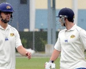 Successful Otago batsmen Sam Wells (left) and Neil Broom walk off the field in their side Plunket...