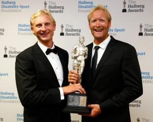 Supreme Halberg Award winners Hamish Bond (L) and Eric Murray pose with the trophy at the awards...