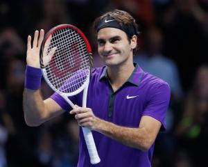 Switzerland's Roger Federer celebrates winning his men's singles semifinal against Britain's Andy...