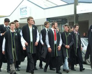 Telford diploma of rural business graduates brave strong winds as they parade through the main...