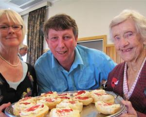 Tempting Myrtle Whittington with scones at the Anzac Day Diggers Breakfast in Wanaka yesterday...