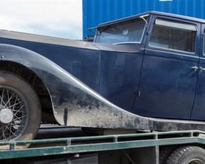 The 1922 Rolls-Royce Silver Ghost belonging to Michael Swann is trailered to a secure location...