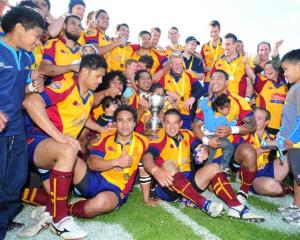 The champion North Otago rugby team celebrates its 39-18 win over Wanganui in the Meads Cup in...