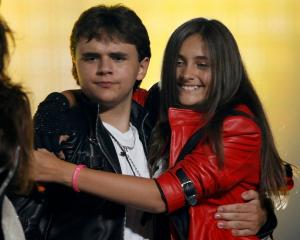 The children of late singer Michael Jackson, Prince Michael Joseph Jackson Jr. (L) and Paris...