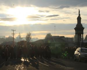 The crowd at the service at the Balclutha cenotaph were asked to think of the town 100 years ago...