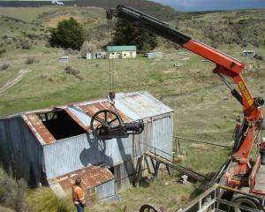The gold stamp battery engine being lifted out of a historic building at Macraes mine on Thursday...