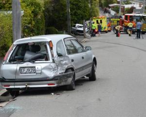 The hatchback struck by a Nissan sedan as it careered down Signal Hill Rd on Saturday. Photos by...