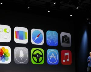 The new Apple iOS 7 features are displayed on screen  at Apple's  developers' conference in San...