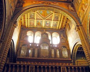 The pipe organ and ornately painted walls at St Peter's Cathedral in Pecs, Hungary. Photo:...