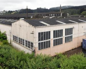 The run-down Iron Roller Mills Building in Green Island. Photo by Gerard O'Brien.