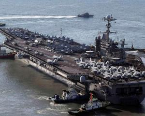 The USS George Washington arrives at the port of Busan in South Korea. REUTERS/Cho Jung-Ho/Yonhap