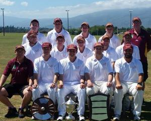The victorious North Otago team with the spoils following its Hawke Cup win against Buller...