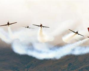 The Yak 52 team perform a starburst move. Photo by Stephen Jaquiery.