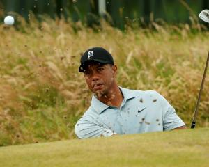 Tiger Woods practises on the chipping green ahead of the British Open Championship at the Royal...