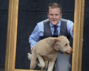 Toitu Otago Settlers Museum exhibition developer William McKee, with his dog Louis (2), is...