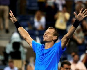 Tomas Berdych of the Czech Republic celebrates after defeating Roger Federer of Switzerland in...