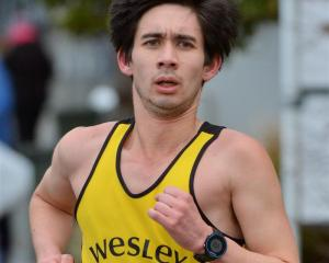 Tony Payne on his way to a win in the half marathon yesterday. Photo by Gerard O'Brien.