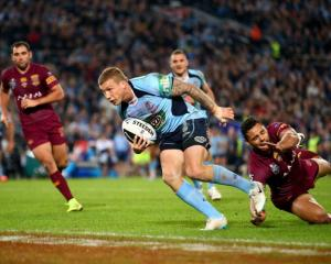 Trent Hodkinson crosses to score for New South Wales against Queensland. (Photo by Mark Nolan...