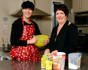 Trista Townsend and mother Elaine Schuck  prepare for next week's baking fundraiser. Photo by...