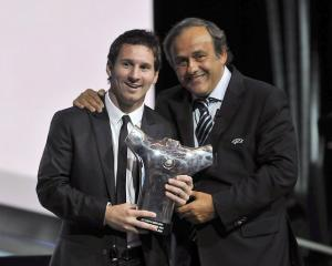 UEFA President Michel Platini (R) poses with Barcelona's Lionel Messi, who was named the Best...