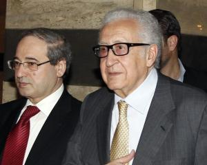 UN envoy Lakhdar Brahimi (C) returns to a hotel after meeting Syria's President Bashar al-Assad...