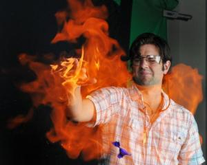 University of Otago chemistry PhD student Dan Hutchinson uses his flaming hand to burst and...
