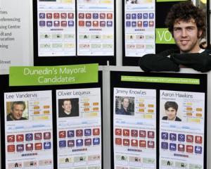 University of Otago politics and design student Niko Elsen shows off his display demystifying...