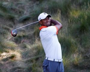 US golfer Tiger Woods tees off on the 18th hole during a practice round for the 2013 US Open at...