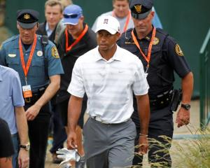 US golfer Tiger Woods walks to the 18th green during a practice round for the 2013 US Open at the...